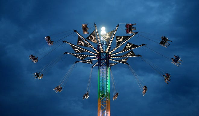 Fairgoers enjoy one of the rides on opening night of the Williamson County Fair on Aug. 5, 2016.