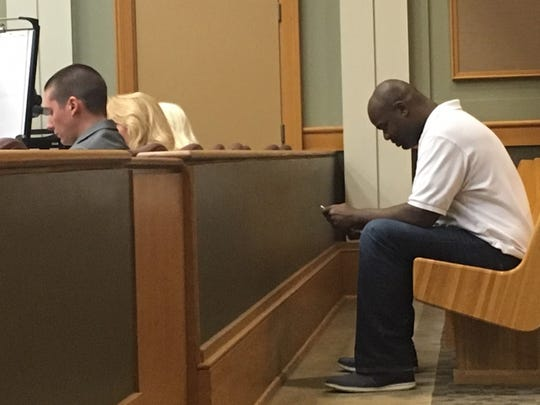 Albert Haynesworth sits in a Williamson County courtroom, waiting for a judge to hear his case on July 25, 2019.