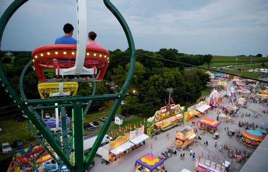 Fairgoers check out the view of the midway from the top of the Seattle Wheel at the Williamson County Fair in Franklin on Aug. 5, 2016.