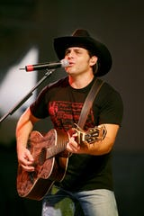 Country singer Rhett Akins performs on opening night of the Williamson County Fair Aug. 4, 2006.