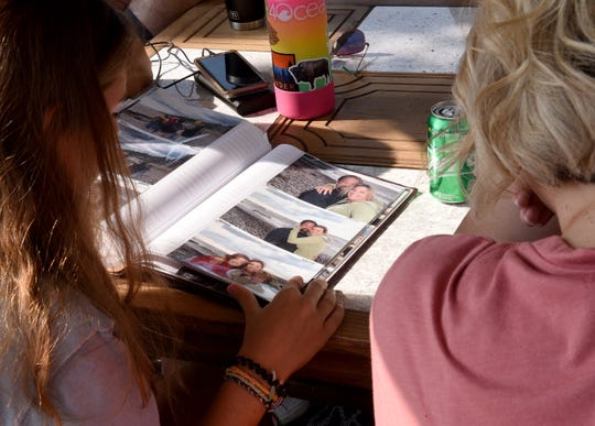 "Stepdaughter Brandi Hafen and sister-in-law Stacey Hall sit together and look through family photos of Corby Hall. ""Corby was the kind of dude that Brandi and I were asking to be our dad before he asked us for permission to marry our mom,"" Brandi's brother,ÊBlaine Hafen said."