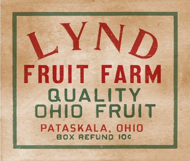 One of the original signs, on a kind of balsa wood, for Lynd Fruit Farm.