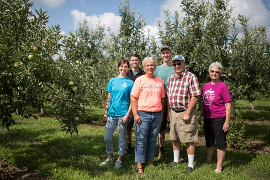 A few members of the Lynd family pose for a portrait in the apple orchard behind their market on Morse Road. Lynd Fruit Farm is celebrating 100 years at the Morse location. Pictured from left are Angie Lynd-Wilcox, Cody Wilcox, Debbie Lynd Patton, Noah Lynd, Mitch Lynd and Penny Lynd.