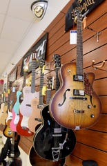 Electric guitars for sale at Martin Music on 21st Street in Newark. Martin Music, which has been in business for 71 years, is planning to close its doors July 31.