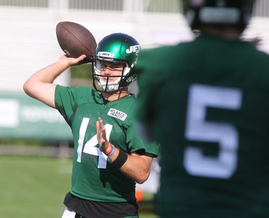 Quarterback Sam Darnold throwing the ball to Davis Webb on the first day of training camp for the NY Jets at the Atlantic Health Training Center in Florham Park, NJ on July 25, 2019.