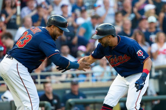 Jul 24, 2019; Minneapolis, MN, USA; Minnesota Twins outfielder Eddie Rosario (20) celebrates his home run with designated hitter Nelson Cruz (23) in the first inning against New York Yankees at Target Field.