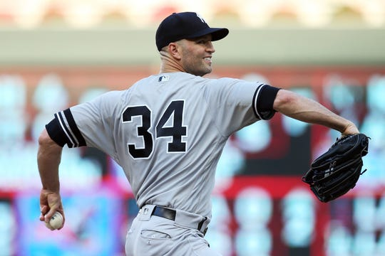 New York Yankees' pitcher J.A. Happ throws against the Minnesota Twins in the first inning of a game Wednesday, July 24, 2019, in Minneapolis.