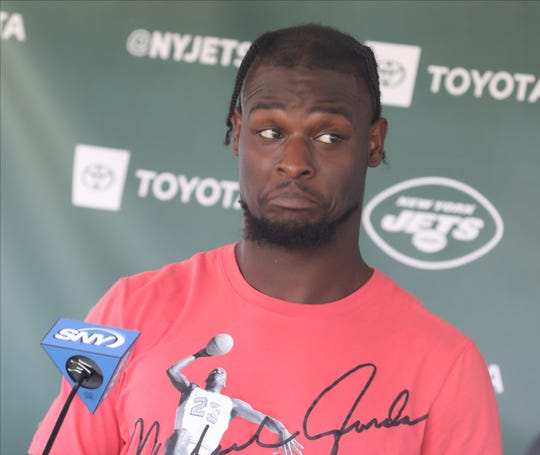 Running back Le'Veon Bell talks during a press conference following the first day of training camp for the NY Jets at the Atlantic Health Training Center in Florham Park, NJ on July 25, 2019.