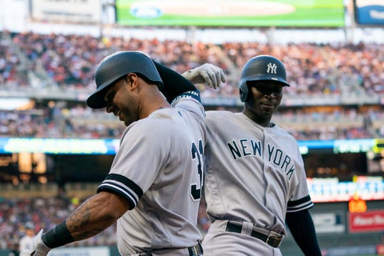 Jul 24, 2019; Minneapolis, MN, USA; New York Yankees outfielder Aaron Hicks (31) celebrates his home run with shortstop Didi Gregorius, facing, in the third inning against Minnesota Twins at Target Field.
