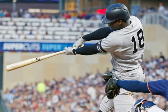 New York Yankees' Didi Gregorius hits a two-run triple off Minnesota Twins pitcher Jake Odorizzi in the fourth inning of a game Wednesday, July 24, 2019, in Minneapolis.