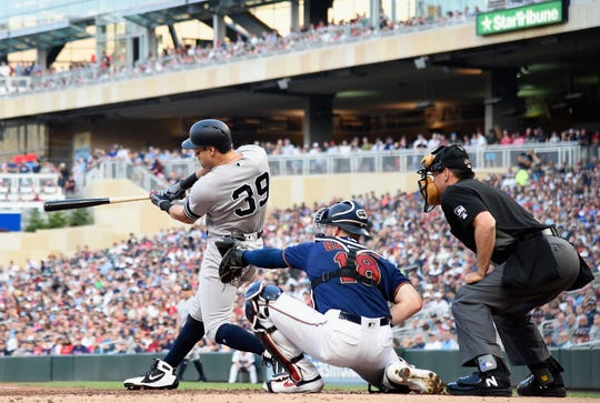 Mike Tauchman #39 of the New York Yankees hits a two-run triple against the Minnesota Twins during the second inning of the game on July 24, 2019 at Target Field in Minneapolis, Minnesota.