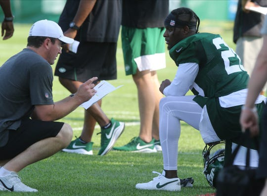 Running backs coach Jon Bob Cooter talks with Le'Veon Bell during a break on the first day of training camp for the NY Jets at the Atlantic Health Training Center in Florham Park, NJ on July 25, 2019.