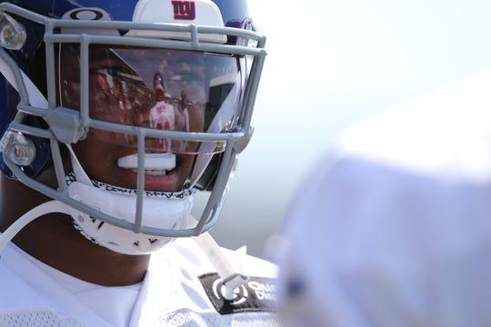 Saquon Barkley looks towards Eli Penny, at Giants practice, Thursday, July 25, 2019.