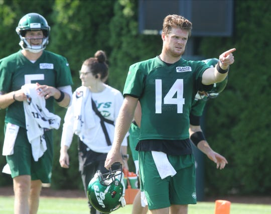 Quarterback, Sam Darnold guides the quarterbacks to the next practice field on the first day of training camp for the NY Jets at the Atlantic Health Training Center in Florham Park, NJ on July 25, 2019.