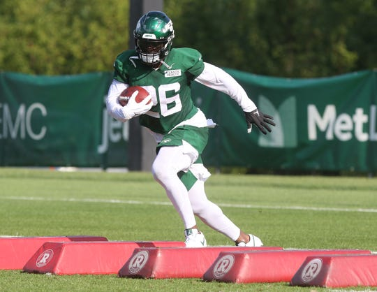 Running back Le'Veon Bell works on agility during the first day of training camp for the NY Jets at the Atlantic Health Training Center in Florham Park, NJ on July 25, 2019.