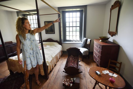 Jessica Bush, curator of the Dey Mansion, a museum owned by Passaic County in Wayne, points to a mirror on loan to the house from Grace Russell, a philanthropist who died 70 years ago.