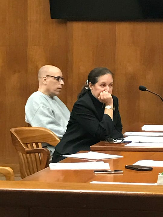Keith Knight sits with his attorney, Milagros Camacho, in Superior Court in Hackensack on Thursday.
