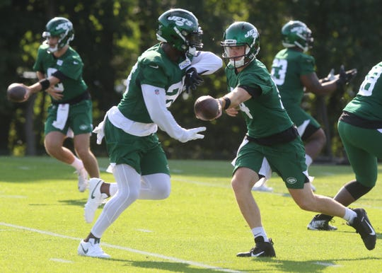 Quarterback Sam Darnold hands the ball off to running back Le'Veon Bell on the first day of training camp for the NY Jets at the Atlantic Health Training Center in Florham Park, NJ on July 25, 2019.