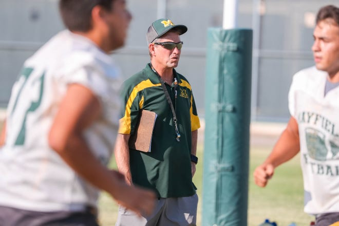 Head coach Michael Bradley coaches  practice at the Mayfield High School football practice field in Las Cruces on Wednesday, July 24, 2019.