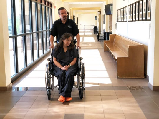Martha Crouch is wheeled into District Judge Curtis Gurley's courtroom on July 25, 2019, at the Aztec District Court building.