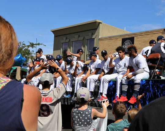 Florida Legends players ride on a float during the Connie Mack parade.