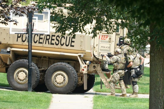 With automatic rifles up, Oakland County SWAT team members prepare to approach the home of a potentially barricaded gunman at his Venice Drive home in Novi on July 25, 2019.