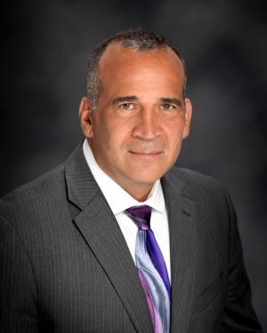 Farmington Superintendent Robert Herrera resigned his post after claiming a school board member was harassing him.