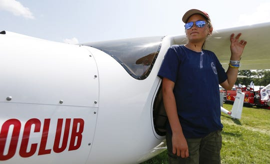 Riley Speidel, 14, of Monterey, California, poses with the Pipistrel Sinus glider she flew from California to Maine earlier this year.