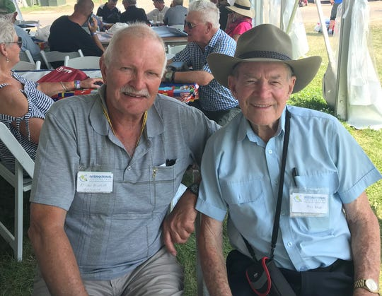 Adrian Heinrich, left, and Bill Babb of Australia, hang out in the International Visitors Tent, just off of Boeing Plaza on Thursday, July 25, 2019, at EAA AirVenture 2019 in Oshkosh.