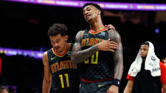 Trae Young (11) and John Collins are the present and future in Atlanta.