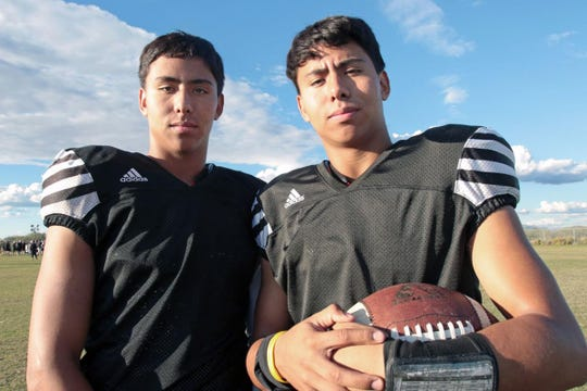 Alex, left, and Jordan Lopez are twin brothers who play football at Walden Grove.