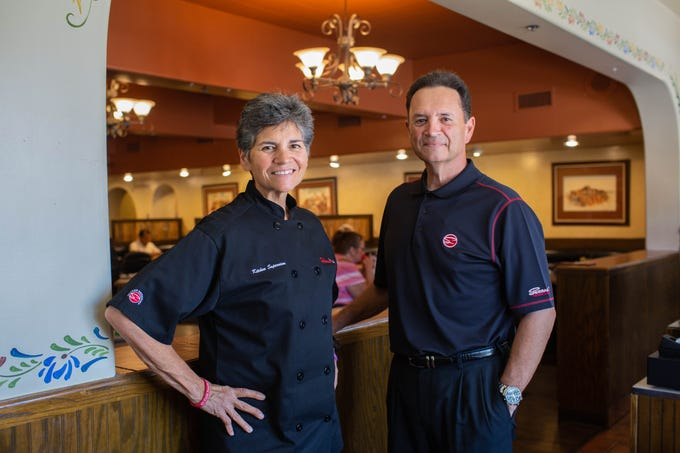 Ric Serrano, CEO of Serrano's Mexican Restaurants, and his sister Lorraine Serrano, who is chef and kitchen supervisor, pose for a photo in their Downtown Chandler location on July 16, 2019.