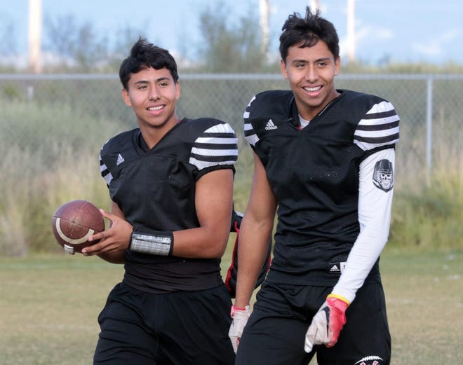 Twin brothers Alex, left, and Jordan Lopez play for Walden Grove. Alex, at quarterback, and Jordan, a wide receiver, have played the same positions since starting the game as kids.