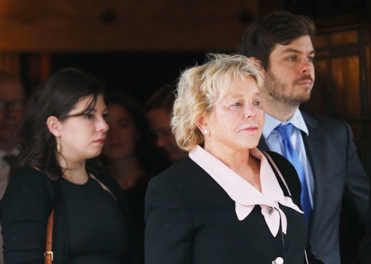 Robert Morgenthau's widow Lucinda Franks is escorted from Temple Emanu-El followed by their children on July 25, 2019.