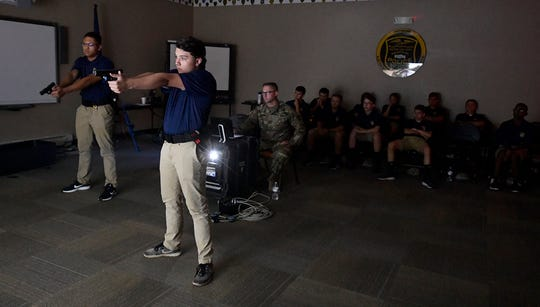 Northern York County Regional Police Explorers Adam Bollinger, 19 left from Central York, and Cameron Taylor, 17 of Dover, take  part in shoot, no-shoot scenarios using the MEGGITT interactive shooting system hosted by members of the PA National Guard, Thursday, July 25, 2019. 