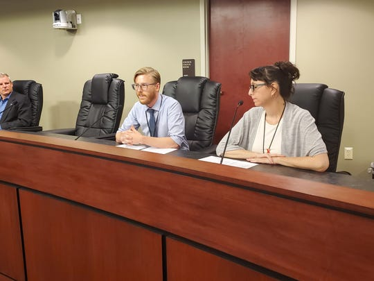 Craig Walt, community health services supervisor, left, and Kim Hall, disease intervention specialist, right, discuss healthcare access in York City.