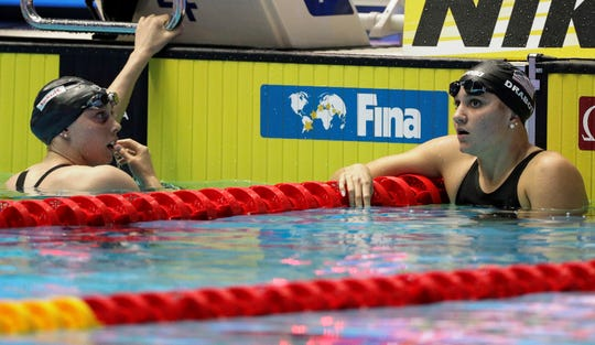 American Hali Flickinger, left, and comptariot Katie Drabot react after the women's 200m butterfly final at the World Swimming Championships in Gwangju, South Korea, Thursday, July 25, 2019. (AP Photo/Mark Schiefelbein)