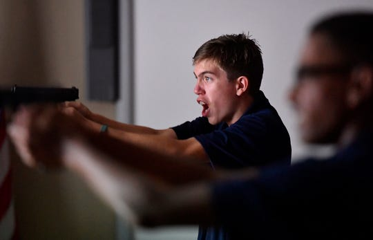 Northern York County Regional Police Explorer Malachi Buer, 15 of Red Lion, yells commands while taking part in shoot, no-shoot scenarios using the MEGGITT interactive shooting system hosted by members of the PA National Guard, Thursday, July 25, 2019. 