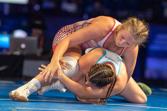 Tiffani Baublitz, top, competes at the United States Junior Women's Freestyle Wrestling Championships in Fargo, North Dakota last week. Baublitz won a gold medal at the 152-pound weight.