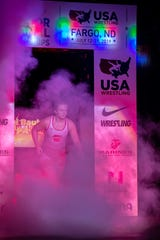 Tiffani Baublitz runs out to the mat at the United States Junior Women's Freestyle Wrestling Championships in Fargo, North Dakota last week. Baublitz won a gold medal at the 152-pound weight class.