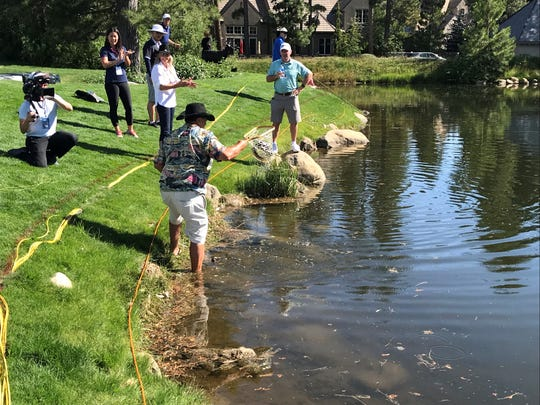 Montreux members give fly-fishing lessons to some of the PGA Tour golfers on Wednesday on the pond at hole No. 18.