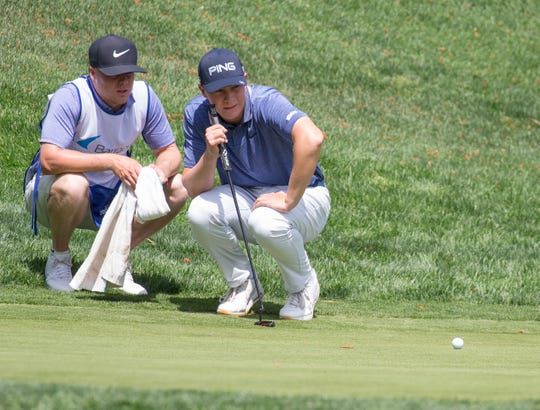 Ollie Osborne lines up a putt on the 10th hole during the Barracuda Championship PGA golf tournament at Montrêux Golf and Country Club in Reno, on Thursday.