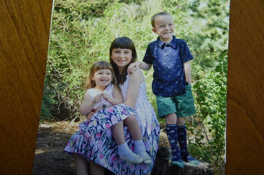 Wendy and Mitch Hammond's daughter Lizzy is seen in a photo with her siblings.