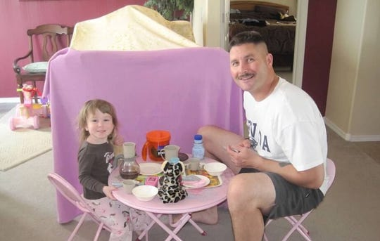 Mitch Hammond and his daughter Lizzy have a princess tea party