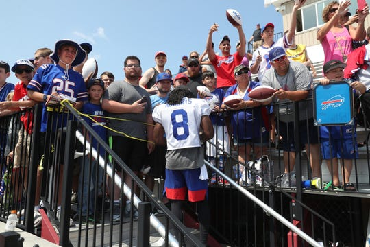 Andre Roberts stops to give autographs on the first day of training camp.