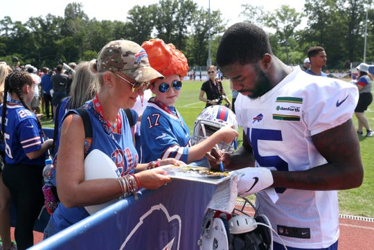 Bills receiver John Brown signs autographs for fans after the first day of training camp.