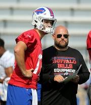 Bills offensive coordinator Brian Daboll with quarterback Josh Allen between plays during training camp.