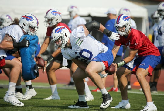 Center Mitch Morse works with starting quarterback Josh Allen early on during training camp. Morse, the Bills top free agent signing, has been sidelined by a concussion for nearly a month and it's wreaked havoc with preparation for the season.