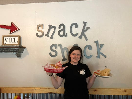 "Paige Gellis with a lunch order in the redecorated dining room at the ""new"" Snack Shack on Eastside Road in south Redding."