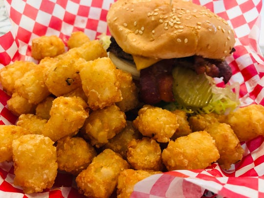 Popular bacon cheeseburger with tater tots at the Snack Shack.